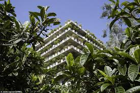 High Heat Plants Flower Tower In Paris Is Completely Concealed By Hundreds Of