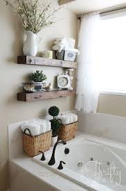 White Bathroom Shelves - floating shelves above the toilet in this bathroom is much