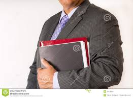 young man holding some file folders man wearing a suit and