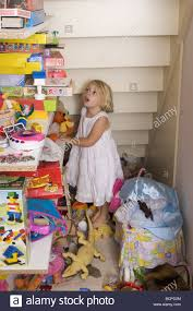 messy closet messy child looking at toys in closet stock photo royalty free