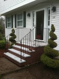 Modern Front Porch Decorating Ideas Charming White Wooden Wall Siding And Black Metal Fences Along
