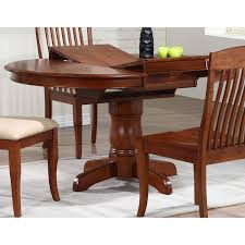 cyrus extending dining table round top pedestal base cinnamon