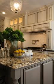 granite countertops for ivory cabinets antique ivory kitchen cabinets with black granite countertops gray