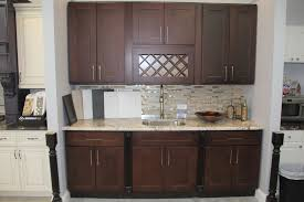 kitchen design dark brown forevermark cabinetry with mosaic tile