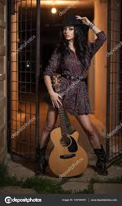 attractive woman with country look indoors shot american country