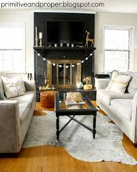 dramatic lamp black fireplace makeover u0026 cowhide rug from rugs usa