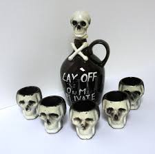 halloween bones background vintage skull poison decanter and 5 shot glasses cross bones