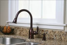 kitchen faucet rubbed bronze rubbed bronze kitchen faucet with stainless steel sink