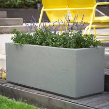 garden boxes ideas gray block stone planter box with plants placed on the gray wooden