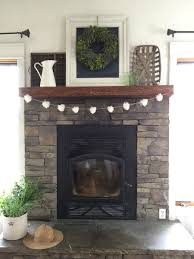 remodelaholic mantel and fireplace makeover with farmhouse charm
