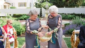 these adorable grandmothers are flower girls at wedding