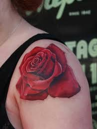 red rose tattoo on left shoulder by anders grucz