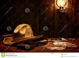 american west cowboy hat and cards in saloon stock photos