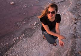 on the shores of a pink lake in australia adventurous kate