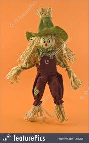 vertical halloween background corn husk scarecrow doll photo