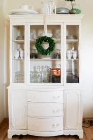 lightly distressed white chalk painted china hutch