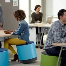 Sitting On A Medicine Ball At Desk 8 Unconventional Chairs For Healthier Sitting Brit Co