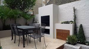 bbq outdoor fire place cream paving modern courtyard garden design