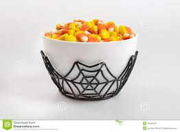 halloween candy background a bowl full of halloween candy corn on a white background stock