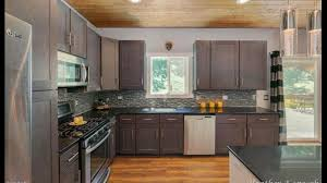 how to stain unfinished oak cabinets how do i get my oak cabinets to this color i ve tried