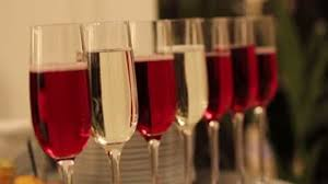 different alcohol drinks in goblets and wine glasses on wedding