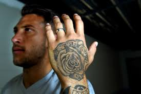 united players share deep meaning u2014 and some regret u2014 on their tattoos