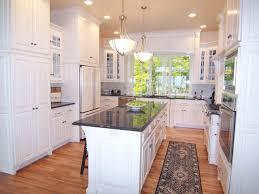 brown wooden cupboard plus concerate floor metal gas range l shape