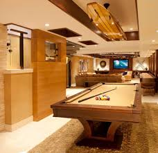 custom game room family room contemporary with pool tables
