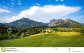 hous a beautiful view of the austrian alps with typical mountain hous