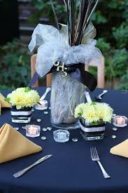 class reunion centerpieces with silk flowers and ribbon in