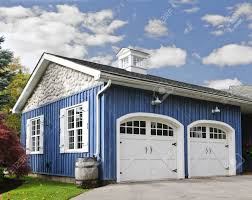 double car garage double car garage with white doors and blue exterior stock photo