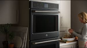 white kitchen cabinets with black slate appliances introducing black slate