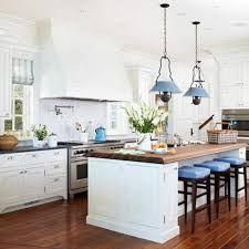 white kitchen island with under counter stool niche and stove