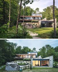 wood and stone cover the exterior of this multi level modern house