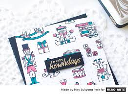 happy holiday card with the christmas toys stamp set hero arts