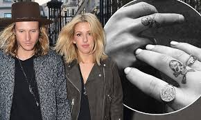 ellie goulding and dougie poynter get matching tattoos on their