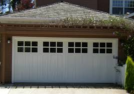 white garage doors carriage house style talking about carriage