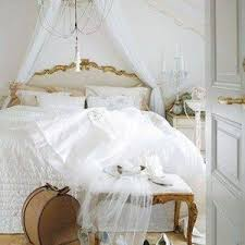 Shabby Chic Metal Bed Frame by Shabby Chic Bedrooms With Clothes Coat And Mirror And Chandelier