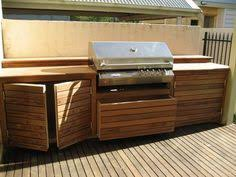 outdoor kitchen island kits an outdoor barbeque island that looks like wooden furniture