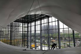 walk among the cloud at rome s convention center a man works on the structure of the new convention center named the cloud la nuvola in italian designed by italian architect massimiliano fuksas on