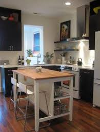 islands in small kitchens take a piece of stock furniture and make it your own black accents