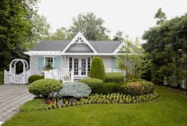 Cottage Curb Appeal - teal shutters for beach style exterior also arched doorway arched