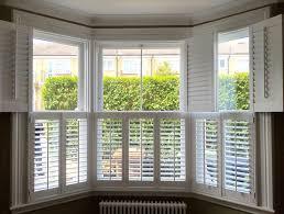 bay window plantation shutters london interior shutters