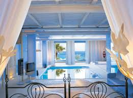 bedroom with pool and sea view one of the best way to wake up in