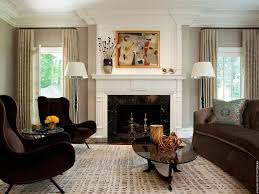 contemporary living room with stone fireplace by david scott