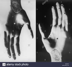 positive and negative hands with spiral and dot tattoos positioned