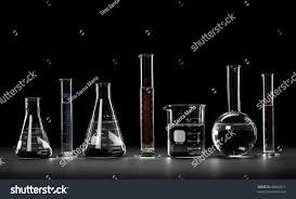 laboratory glassware over black background reflections stock photo