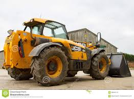 construction digger loader in farm yard with barn editorial image