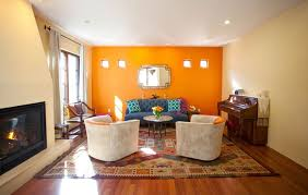 designing and decorating the orange living room for the stylish