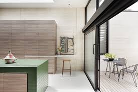 tiled kitchen island in contemporary wood kitchen at layer house
